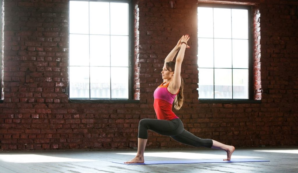 a woman doing yoga in an empty spacious space